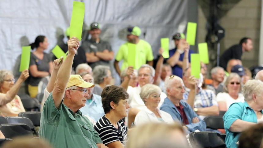 Member-owners vote on advisory motions at Crow Wing Power meeting. (Kelly Humphrey / Brainerd Dispatch)