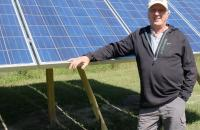 Dan Juhl with solar panels. Photo by MPR News